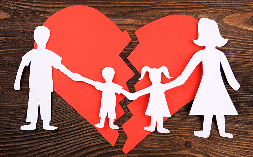 Picture of paper family with broken heart.
