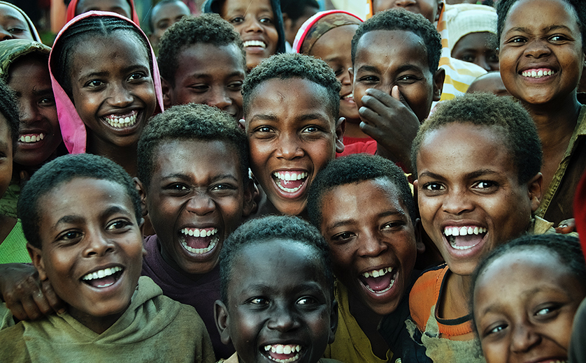 Group of smiling children and adolescents in Ethiopia.