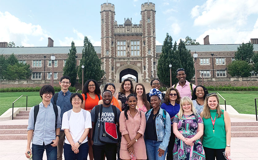 The newest cohort of PhD students on the steps of Brookings Hall.
