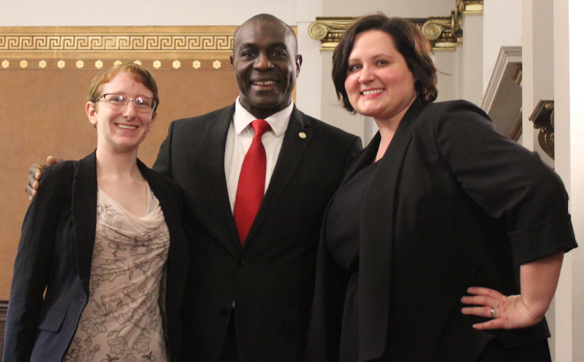 MSW/MSP students Kate Polokonis and Jodie Goodman pose with Board President Lewis Reed