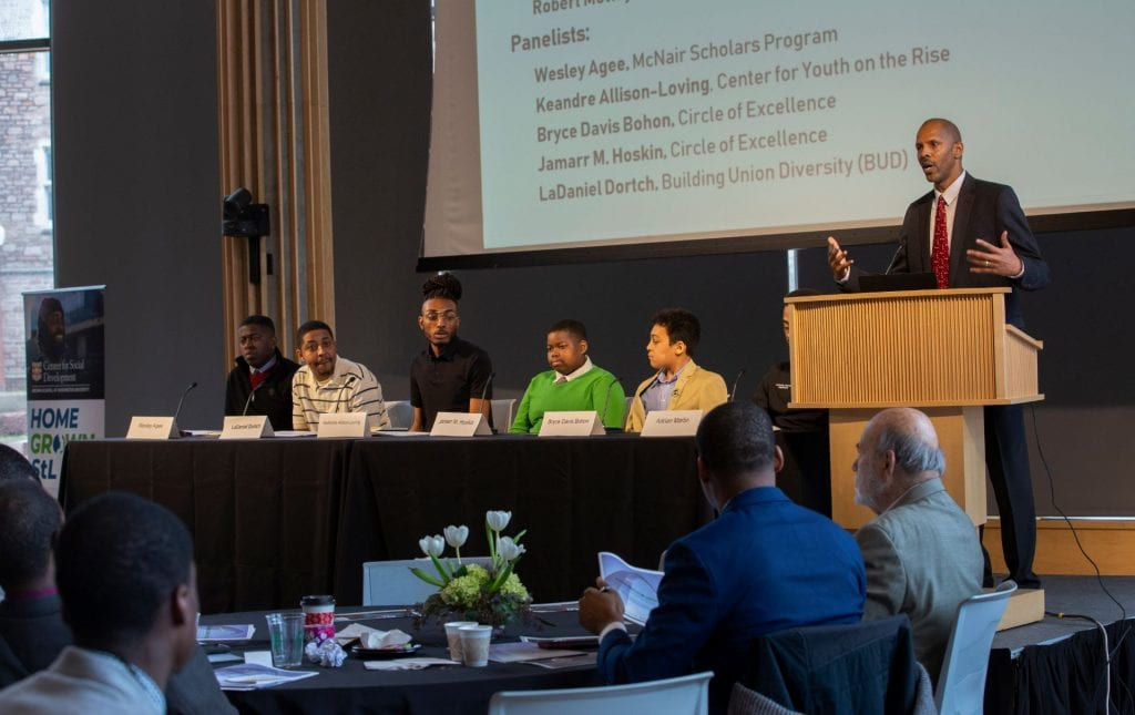 "Robert Motley moderates the ""Champions for Change"" panel of boys and young men during HomeGrown STL's February 2019 summit."
