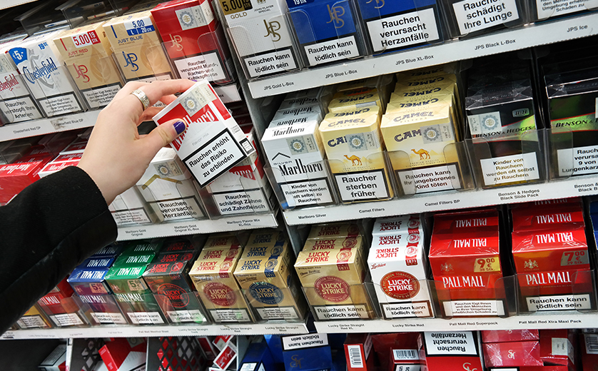 Cigarette cartons on a store shelf