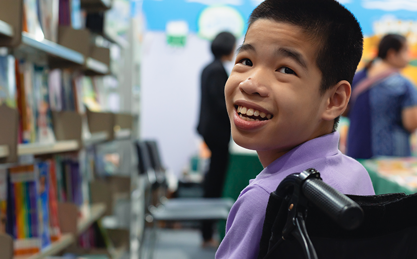 Young boy with special needs at a book fair